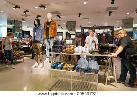 SAINT PETERSBURG, RUSSIA - CIRCA AUGUST, 2017: inside H & M store at Galeria shopping center. H & M  is a Swedish multinational clothing-retail company.
