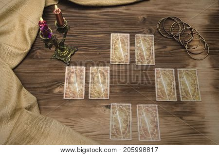 Tarot cards on wooden table. Divination. Fortune teller.