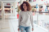 Curly haired girl with freckles in blank grey sweatshirt. Mock up. poster
