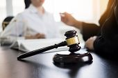 Judge gavel with lawyers advice legal at law firm in background. Concepts of law services. poster