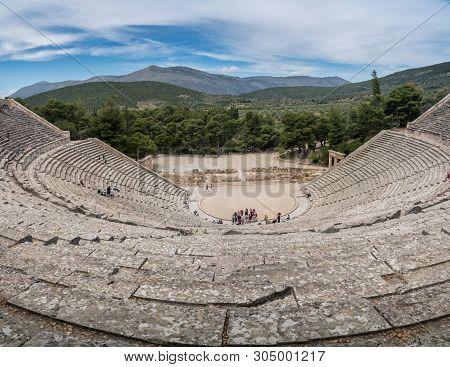 Epidaurus, Greece - 15 May 2019: Tourists In Theater Of The Sanctuary Of Asklepios At Epidaurus