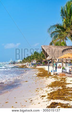 PLAYA DEL CARMEN,MEXICO - APRIL 19,2019 : The beach at Playa del Carmen on a sunny summer day