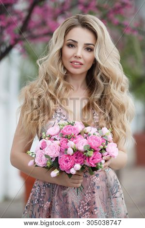 Beautiful Woman In Elegant Evening Dress. Blonde Girl With Long Healthy And Curly Hair. Beautiful Yo