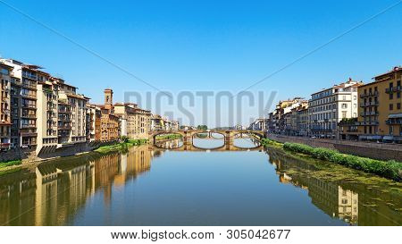 Bridge over river Arno in city Florence is called Trinity. Stone bridge of Florence, Italy, June 2017. Ponte Santa Trinita. poster
