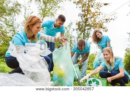 Group of volunteer environmentalists collects waste in a conservation project