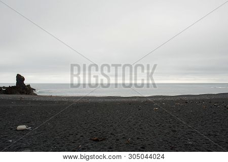 Londrangar Basalt Cliffs in Iceland, Snaefellsnes Peninsula on the Atlantic coast. Migratory seagull nests in colony poster