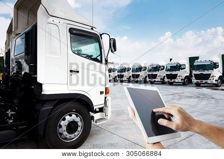 People Hand Is Using Tablet Multiple Photo With New Truck Fleet Is Parking On The Yard For Technolog