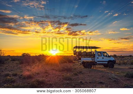 Mariental, Namibia - March 25, 2019 : African 4x4 Safari Vehicle Having A Break In The Kalahari Dese