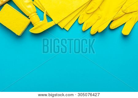 Yellow Cleanser In Plastic Container With Spray, Rubber Protective Gloves, Sponge And Cloths For Cle