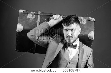 poster of bearded man in suit. stylish esthete with vintage bag. business trip with retro suitcase. heavy bag. mature traveller. businessman in tie. Ready to business trip. Always perfect. Styled for new day