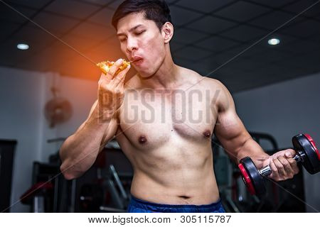 Strong Muscular Athlete Men With Pizza Fast Food. Unhealthy Eating Diet Concept.