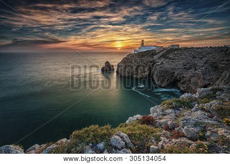 São Vicente Cape Lighthouse At Sunset In Sagres Algarve Portugal