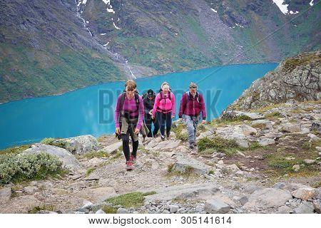 Jotunheimen, Norway - August 1, 2015: People Hike At Besseggen Trail In Jotunheimen National Park, N