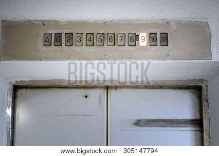 Above Old Elevator Door Light Display With Number Nine Floor. Interior Of The Elevator Inside. View