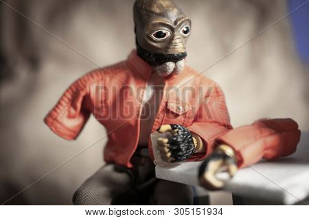 JUNE 1 2018: Humorous scene from Star Wars showing Ponda Baba aka Walrusman and his severed arm after a run in with Obi Wan Kenobi's lightsaber in Mos Eisely cantina - Hasbro action figure