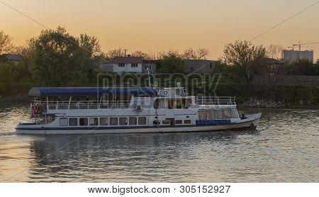 Krasnodar, Russia, May 5, 2019. Kuban River In The Evening In Krasnodar, Pier And River Tram On The