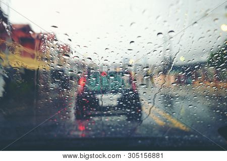 Abstract Traffic In Raining Day. View From Car Seat. Background In Retro Filter. Road View Through C