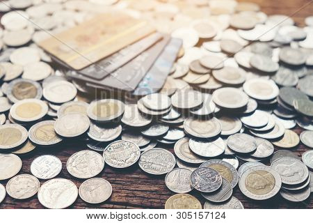 Credit Bank Card, Money And Coins On The Home Wood Table, With Selective Focus, Soft Light And Vinta