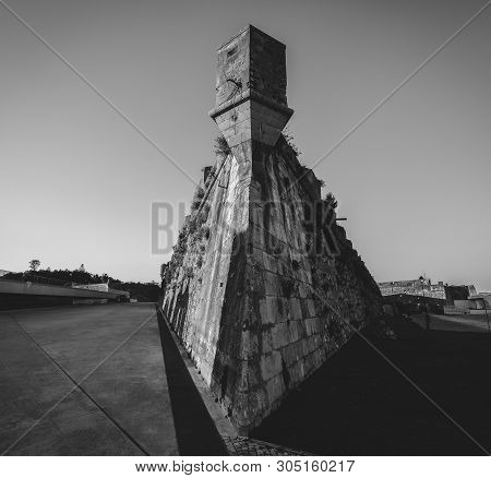 Wide Angle Corner Of Tower At Citadel Of Cascais, Fortress In Cascais, Portugal In Monochrome