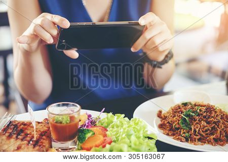 Close-up Woman's Hands Use Pointing Finger Mobile Smart Phone On Food Table, Technology And Home Con