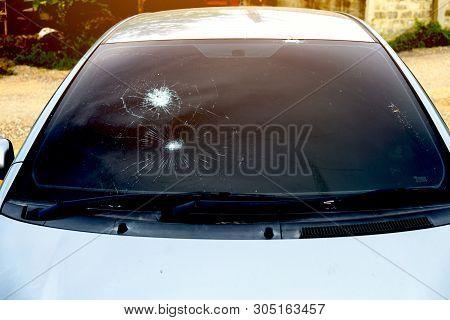 Crash Windshield Glass Of Car,the Broken And Damaged Car