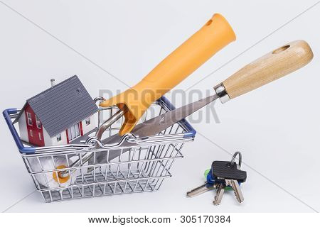 Image Shows Painter Tools With House In A Basket, Isolated On White