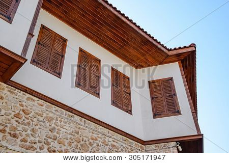 Ancient House With Wooden Shutters On The Windows. City Kaleici In Turkey.