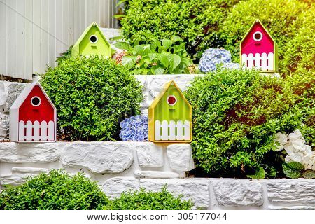 Summer Background - Small Houses With Garden Flowers. Lovely Miniature Houses For Greeting Cards, We