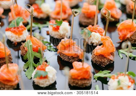Buffet At The Gala Dinner. Assortment Of Canapes. Banquet Service. Catering Food, Snacks With Salmon
