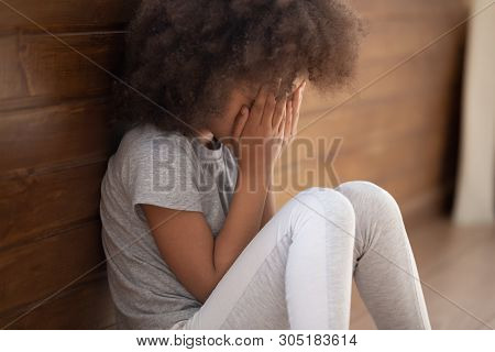 Upset African American Child Girl Crying Sitting Alone On Floor