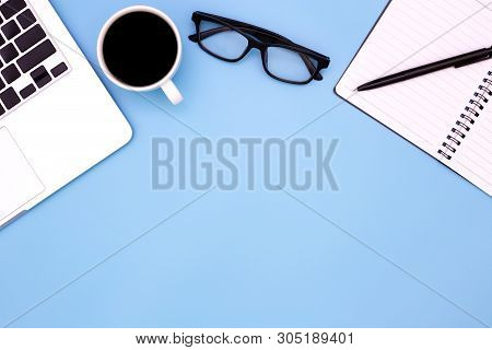 Flat Lay Office Desk Table Of Modern Workplace With Laptop On Blue Table, Top View Laptop Background