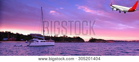 Australian Colourful Cirrus Cloudy Sunrise Seascape With An Anchored Sailboat And Airborne Passenger