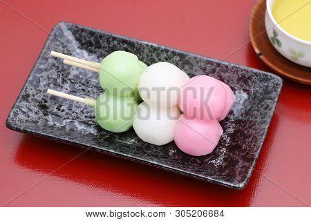 Japanese Traditional Confectionery Sanshoku Dango On Red Background