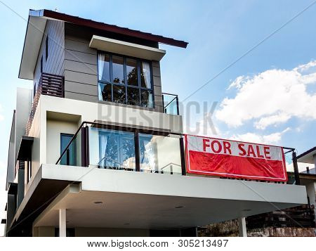 """Singapore, 15 March 2019 - Low Angle Off-centre View Of A House With Red """"for Sale"""" Sign."""