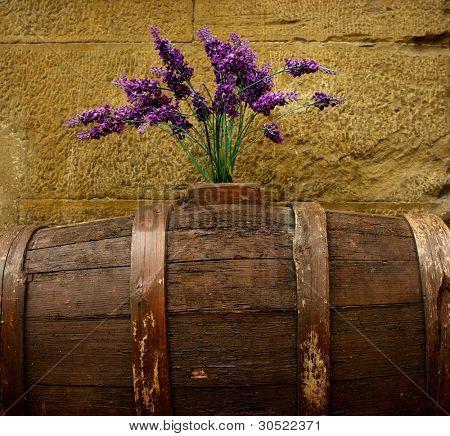 Purple flowers on old barrel.