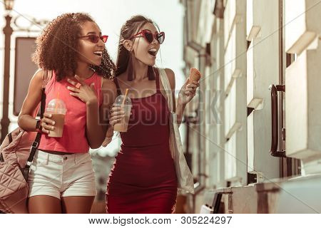 Beautiful Prepossessing Tanned Amazed Sensuous Beauties Enjoying Strolling The Streets.