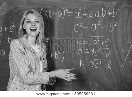 Teacher On School Lesson At Blackboard. Woman In Classroom. Back To School. Teachers Day. Study And