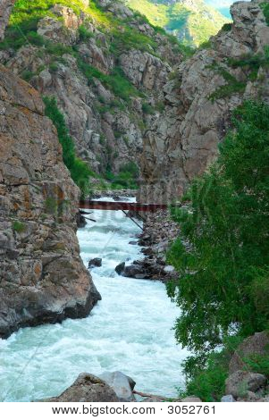 Seethe mountain river rocks and old bridge in Jungarian mountains (Republic of Kazakstan) poster