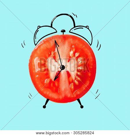Creative Idea Layout Fresh Tomato Slice Alarm Clock On Blue Background. Minimal Idea Business Creati