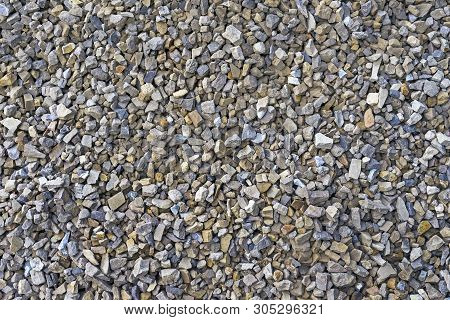 Rubble. Texture and background of crushed stone, pebbles, gravel. Crushed stone. poster