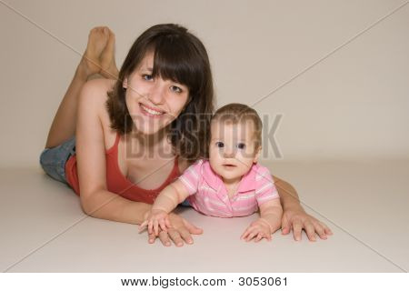 Good Looking Mother With Her Beautiful Baby