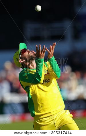 NOTTINGHAM, ENGLAND. 06 JUNE 2019: Glenn Maxwell of Australia takes a catch to dismiss Andre Russell of West Indies during the Australia against West Indies, ICC Cricket World Cup match