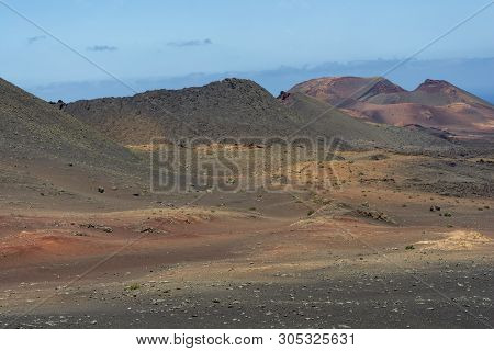 Amazing Crater In A Volcanic Landscape Of Timanfaya National Park, Lanzarote, Canary Islands, Spain