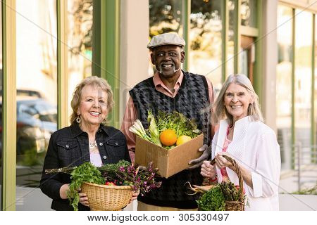 Three Seniors Returning With Groceries From Farmers Market