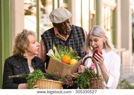 Three Seniors With Groceries From Farmers Market
