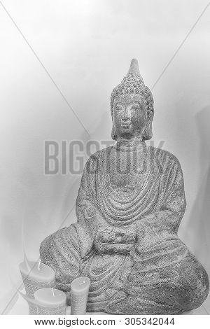 Budha Meditating In Black Background In Reflection