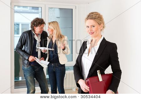 Real estate market - young couple looking for real estate to rent or buy
