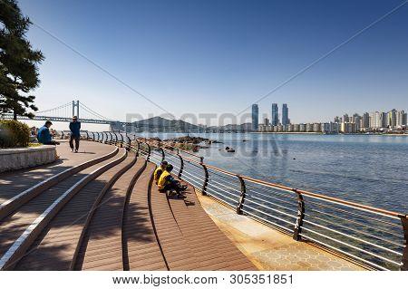 Busan, South Korea - April 2019: Beachfront Promenade With Scenic View Of Gwangan Bridge At Gwangall