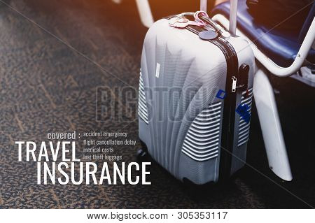 Travel Insurance Concept: Suitcases At Airport Departure Lounge Traveler With Word