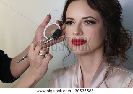 Make-up Artist Working In Make-up Studio, Applies A Make-up Brush To Face. Female Face Close Up.